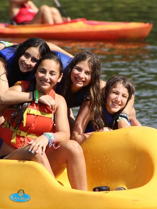 Girls on yellow peddle boat